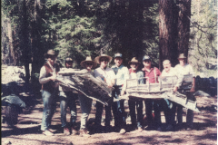 Team members holding wreckage of P-40B