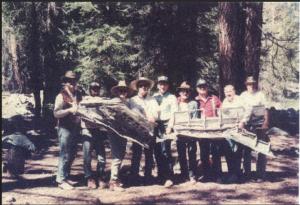 Team members holding wreckage of P-40B